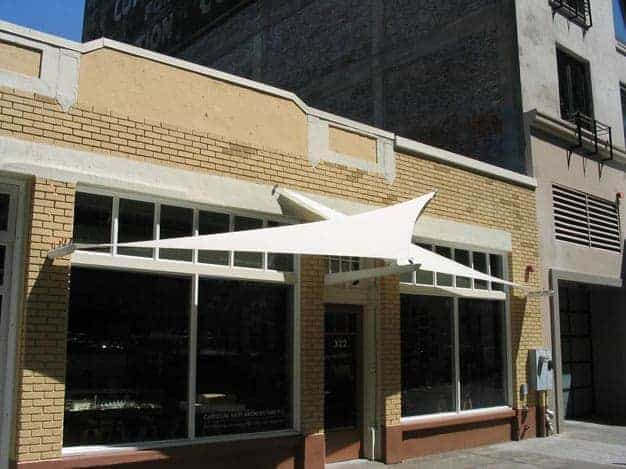 Architectural storefront tension awning